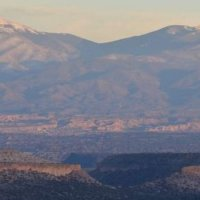 A view to 2 mesas and the Santa Fe mountain
